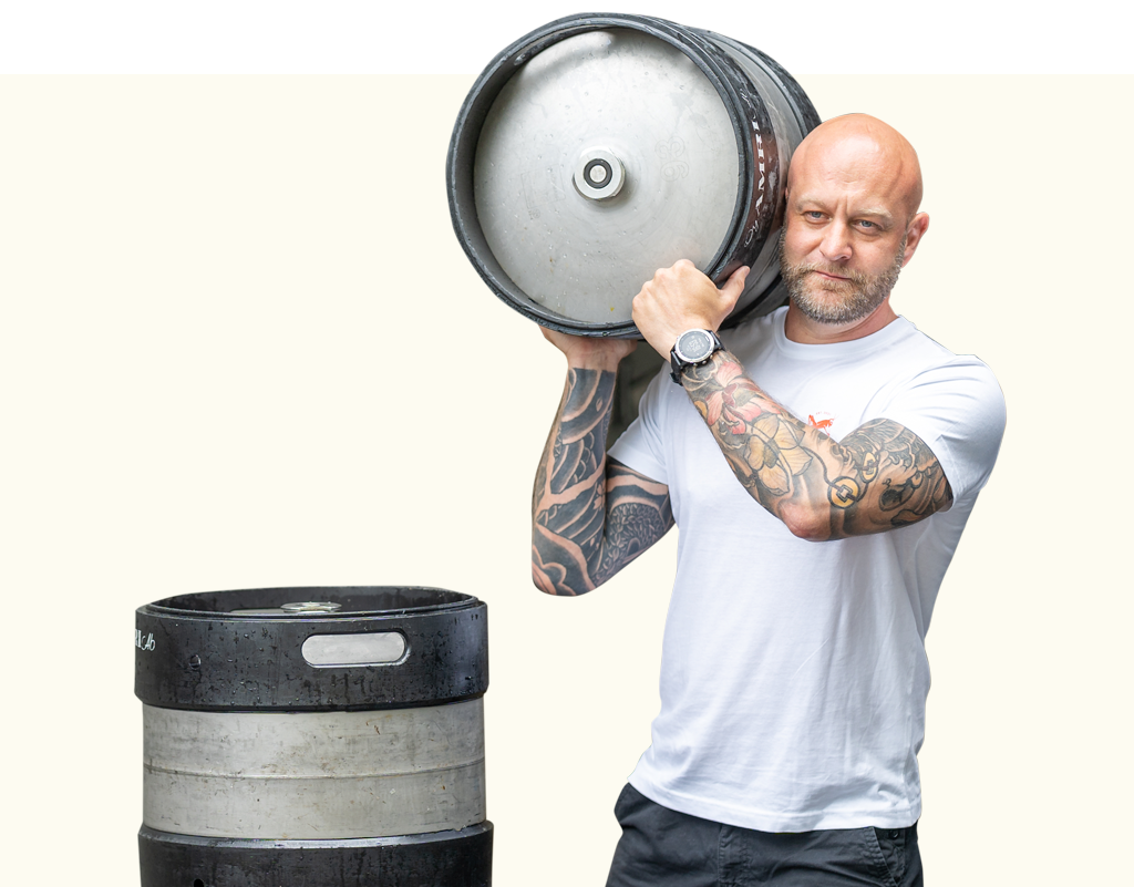 Man carrying a Mad Hopper Brewing Co. beer keg on his shoulder